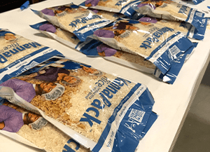 multiple bags of rice sitting on table at charity event