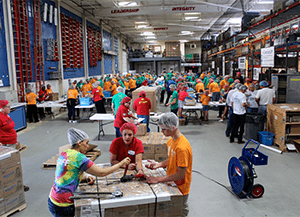 J.C. Restoration volunteers packaging at chairty event