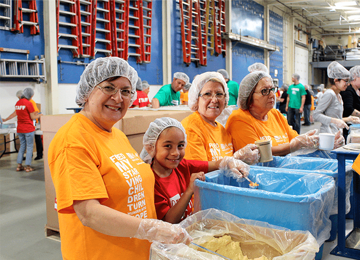 j.c. restoration volunteers packing meals