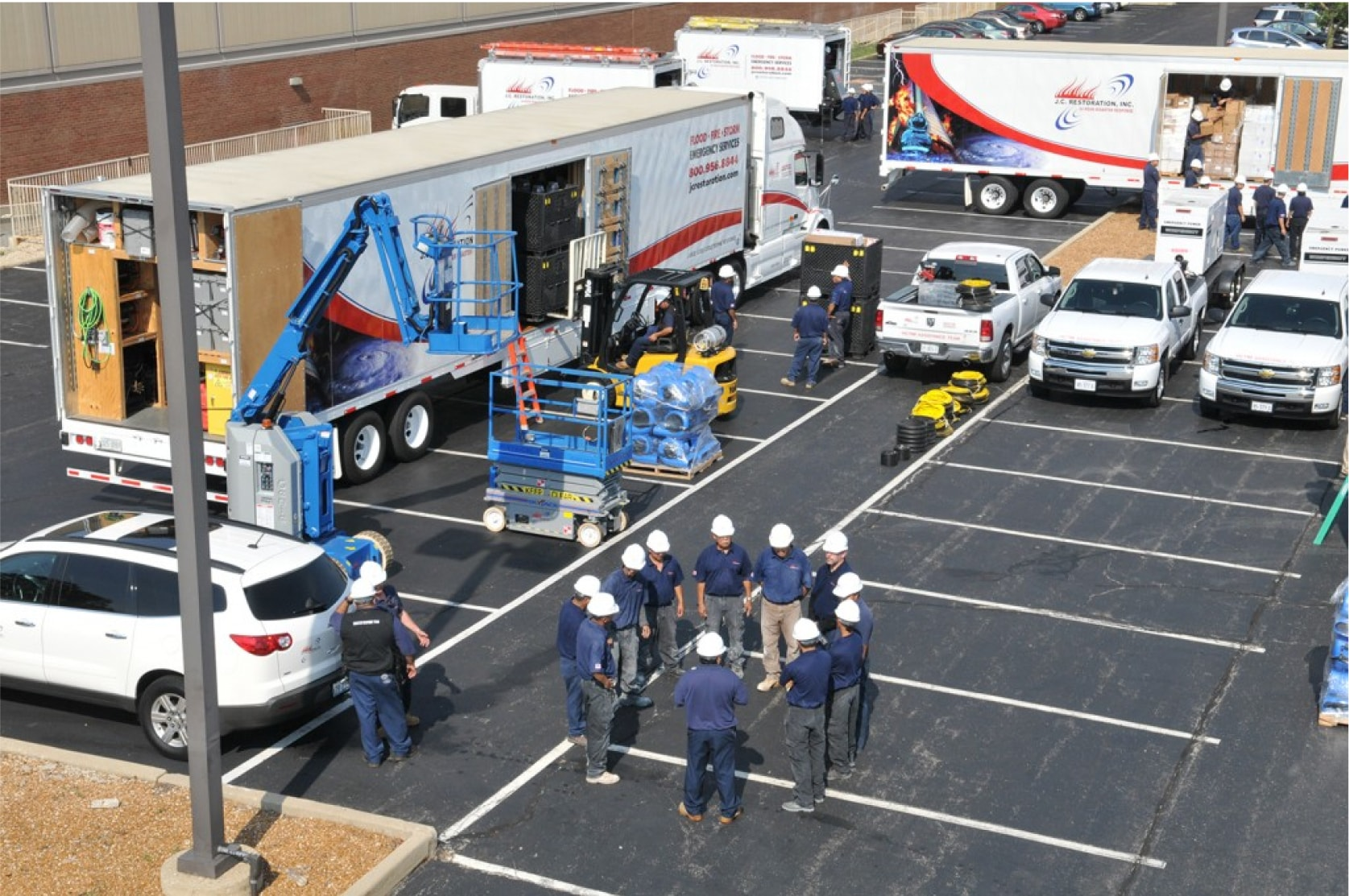J.C. Restoration emergency team with trucks