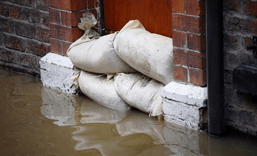 sand bags in front of door to prevent flooding