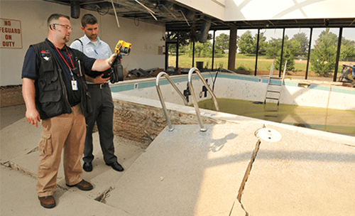 j.c. restoration workers assessing pool