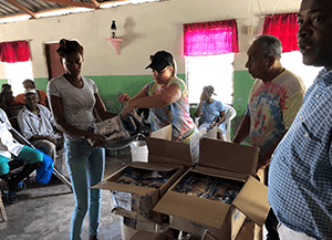 employees handing out meals in Dominican Republic