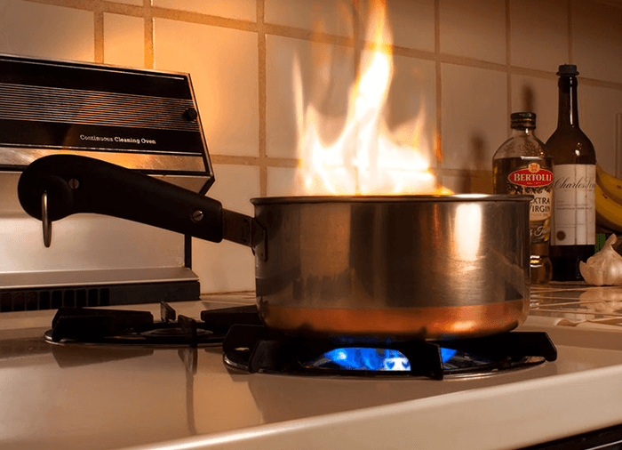 pot on stove on fire