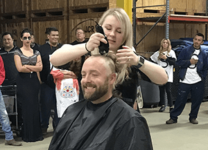 gentleman getting his head shaved
