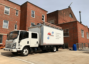 jc restoration truck next to building