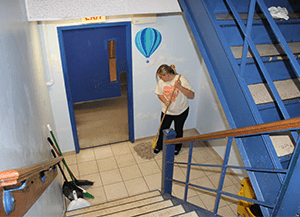 woman mopping in a stair well