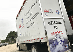 welcome to smoke on the water sign on truck