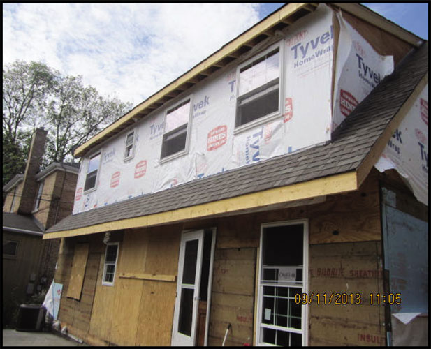 exterior view of residential home getting rebuilt after fire