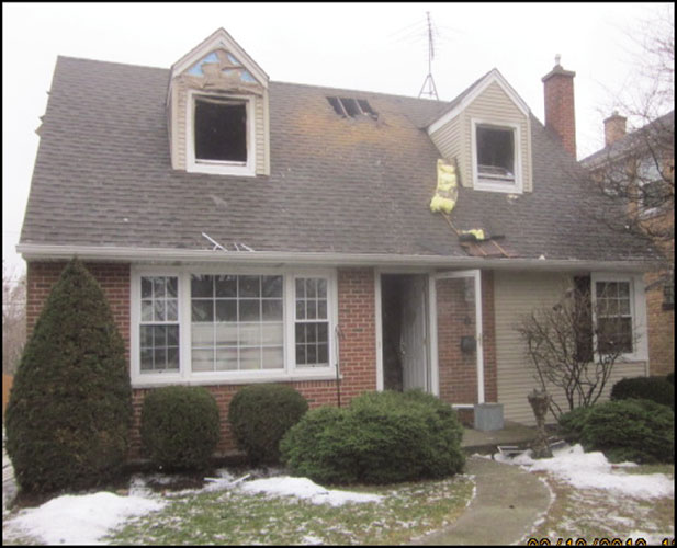 exterior view of residential home with fire damage