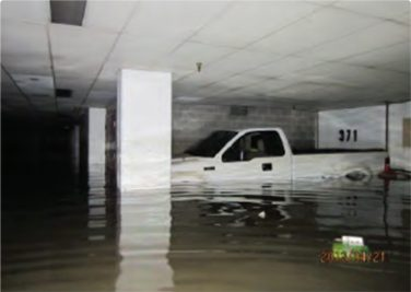 truck submerged in water in parking garage