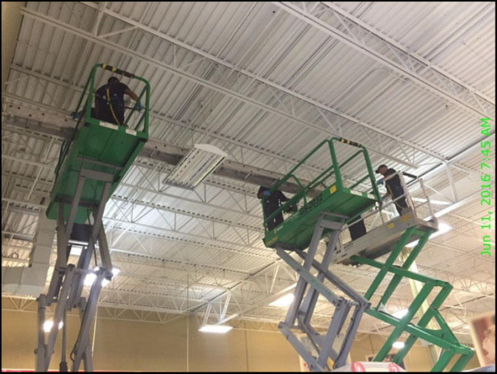 J.C. Restoration team fixing ceiling