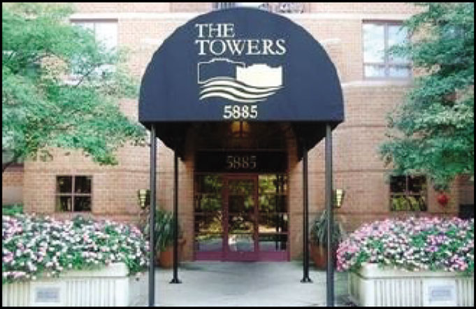 close up of the entrance at The Towers apartments in Lisle, IL