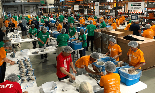 group of volunteers working in warehouse