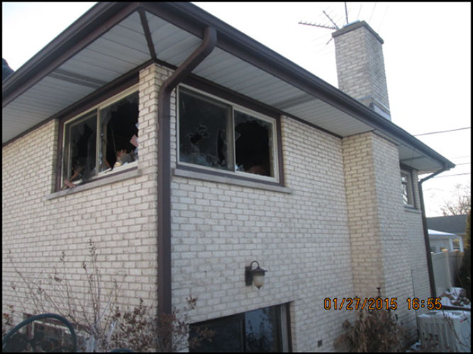 outside of the house with broken windows after fire