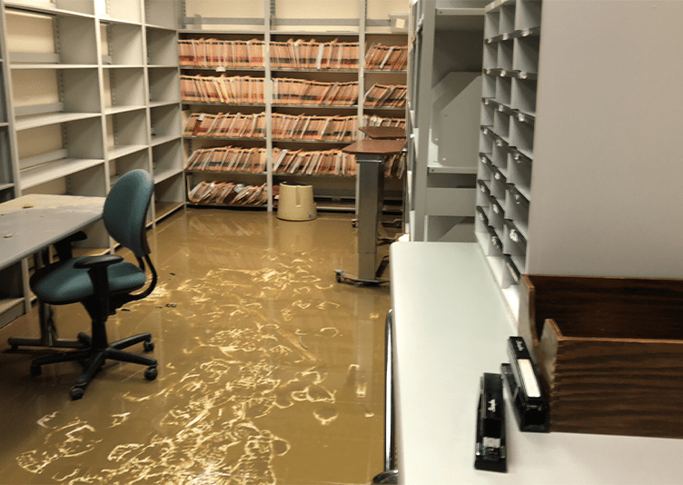 inside stock room in commercial medical building with water damage