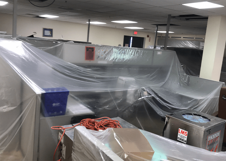 office equipment covered by plastic sheet