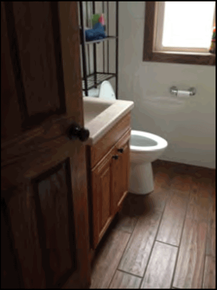 inside bathroom in residential property after fire damage