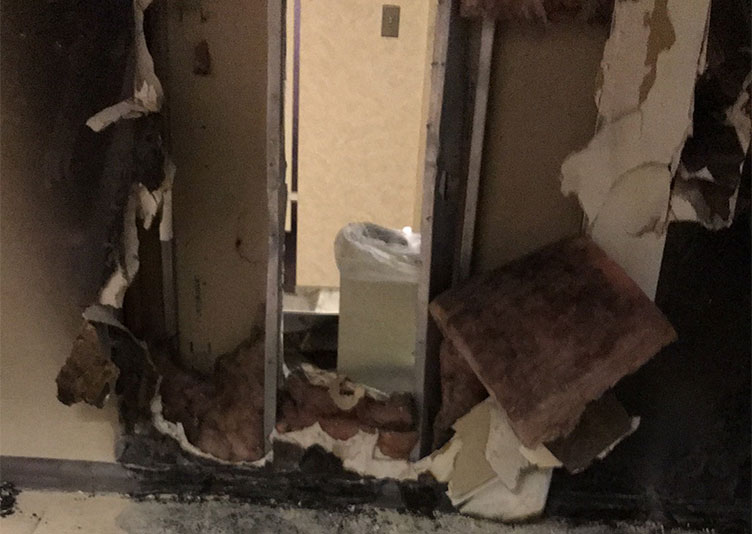 damaged doorway in office building