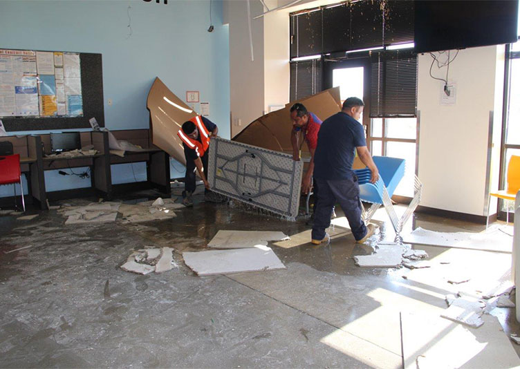 water mitigation team removing unwanted items from cafeteria