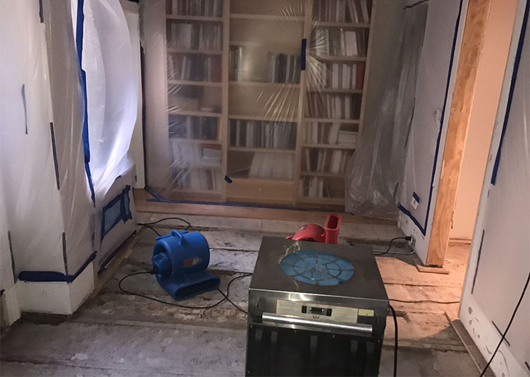 room in apartment damaged from water