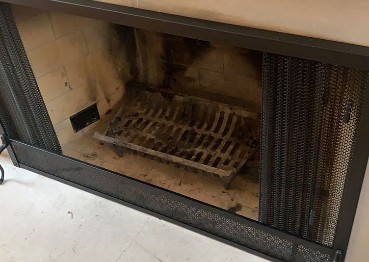damaged fireplace in residential building