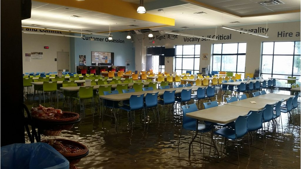 flooded facility in need of commercial water damage restoration