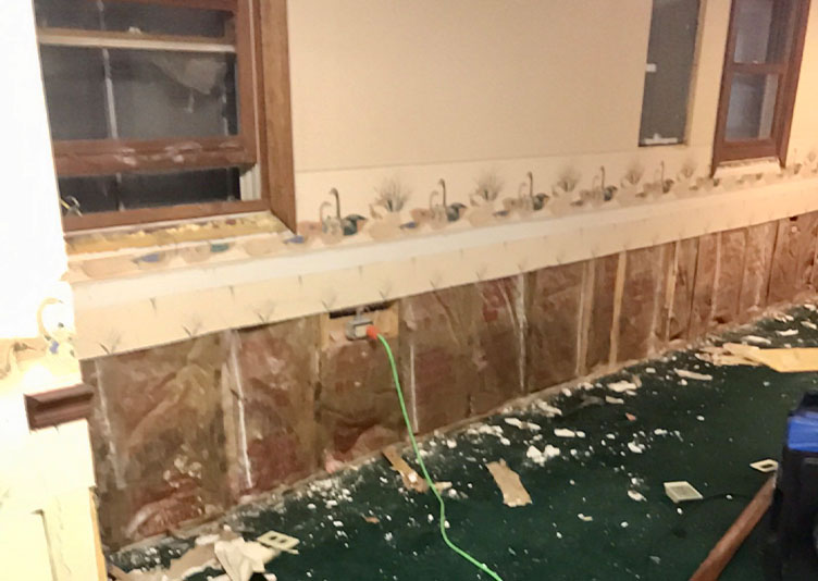 damaged drywall inside of home