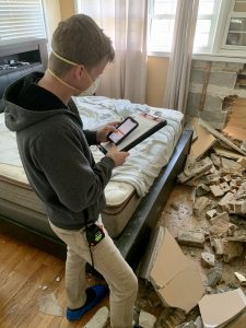 worker examining which residential restoration services are needed for a nearby Chicago home